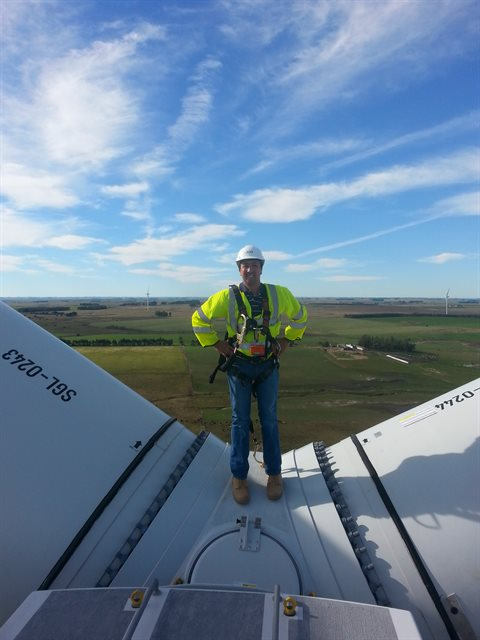 Carlos on top of a wind turbine while conducting a site visit to a wind farm in Uruguay.