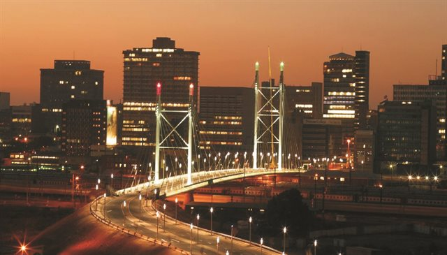 image of Nelson Mandela Bridge illuminated at night