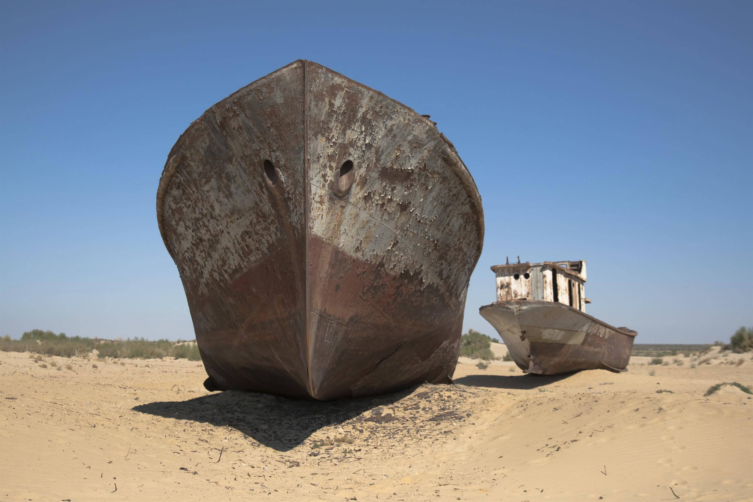 Stranded ships lying on dried up sea bed