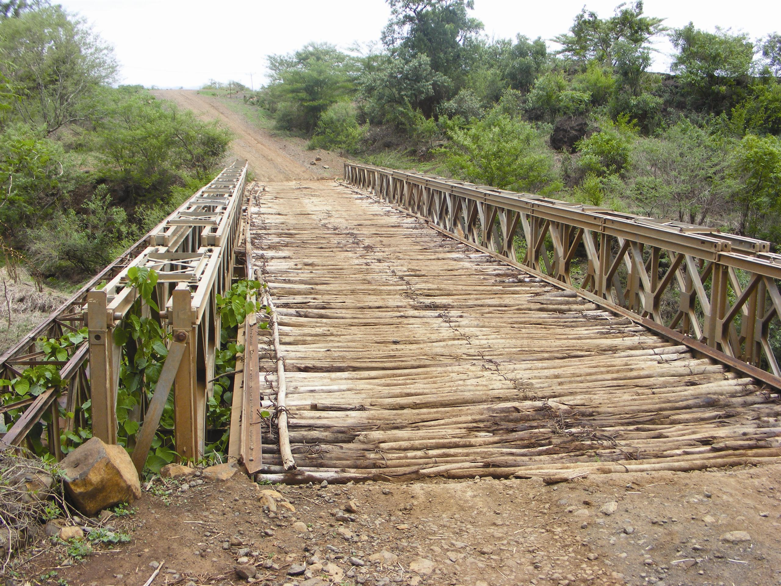 Wooden bridge over river valley