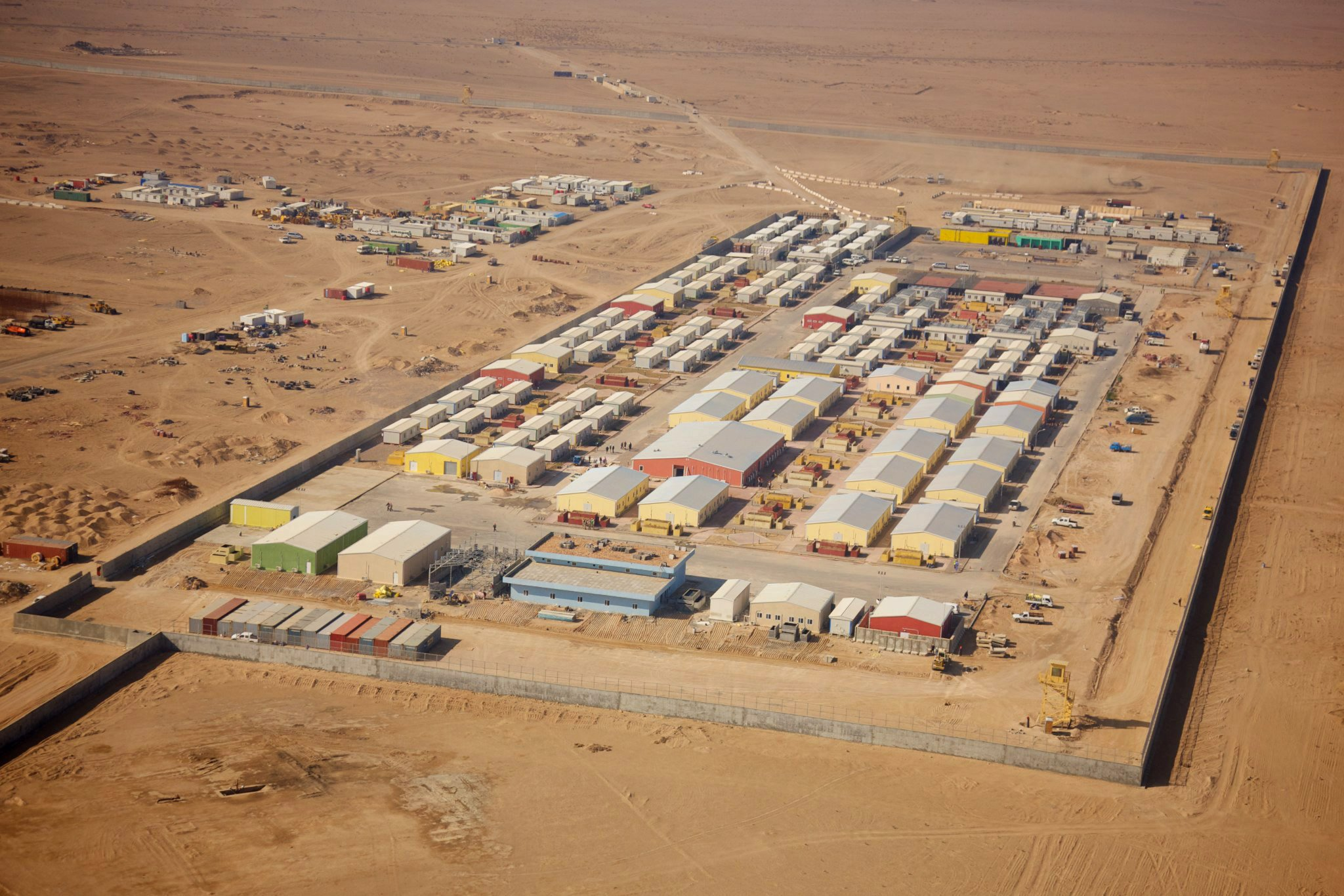 Aerial view of operating base in desert.