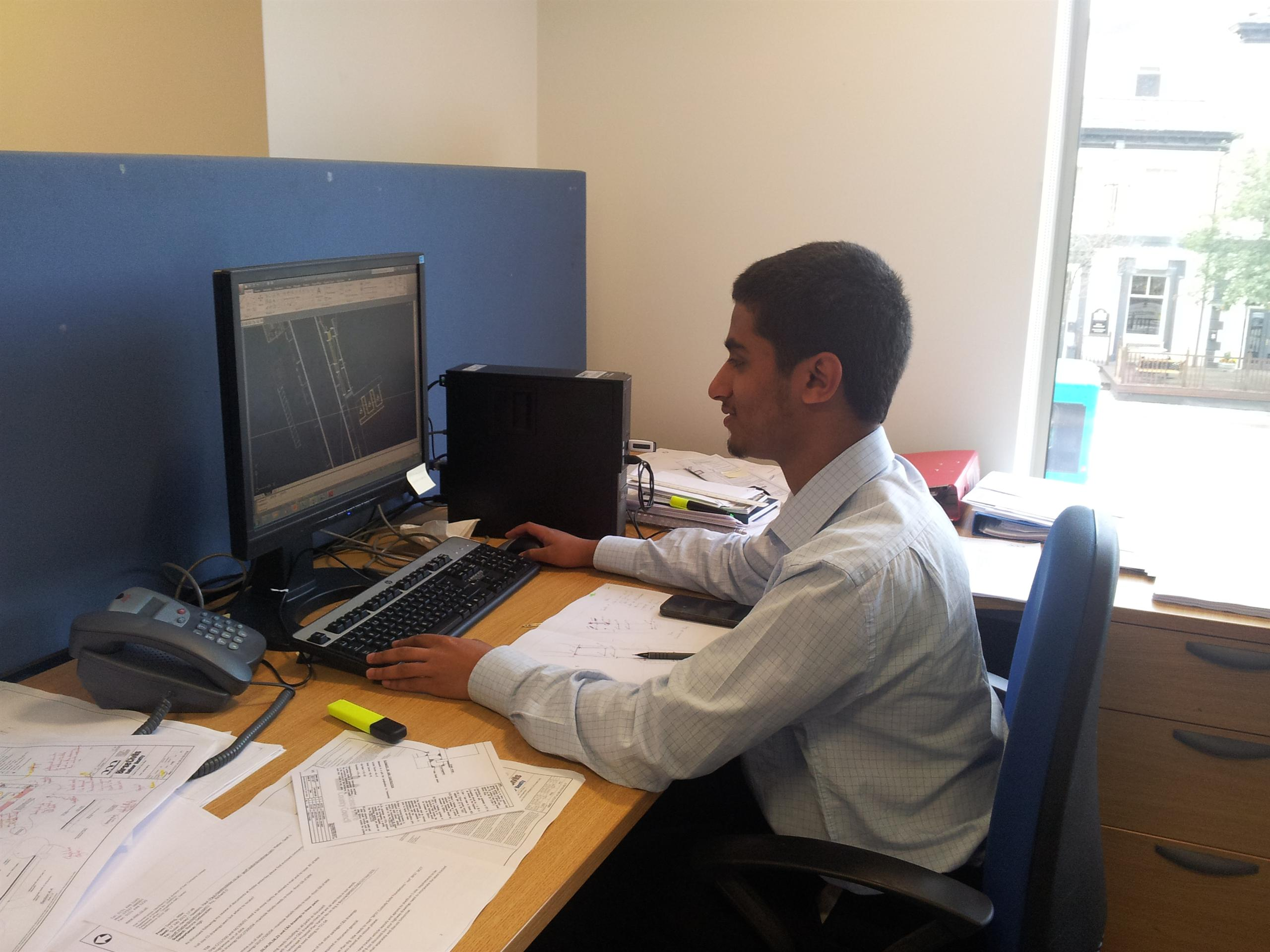 Mustafa in the Manchester office