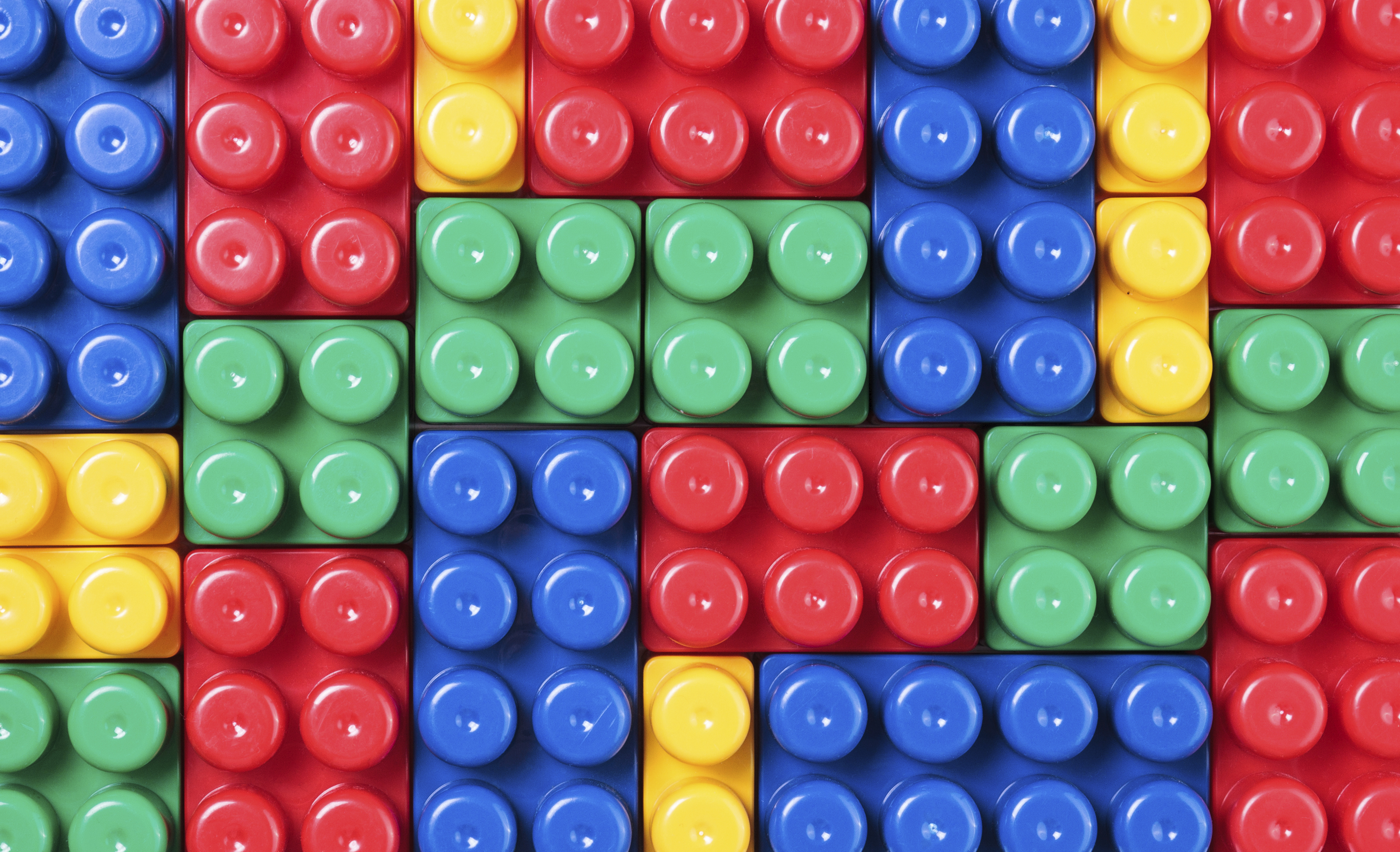 image showing a wall of interlocked toy building blocks