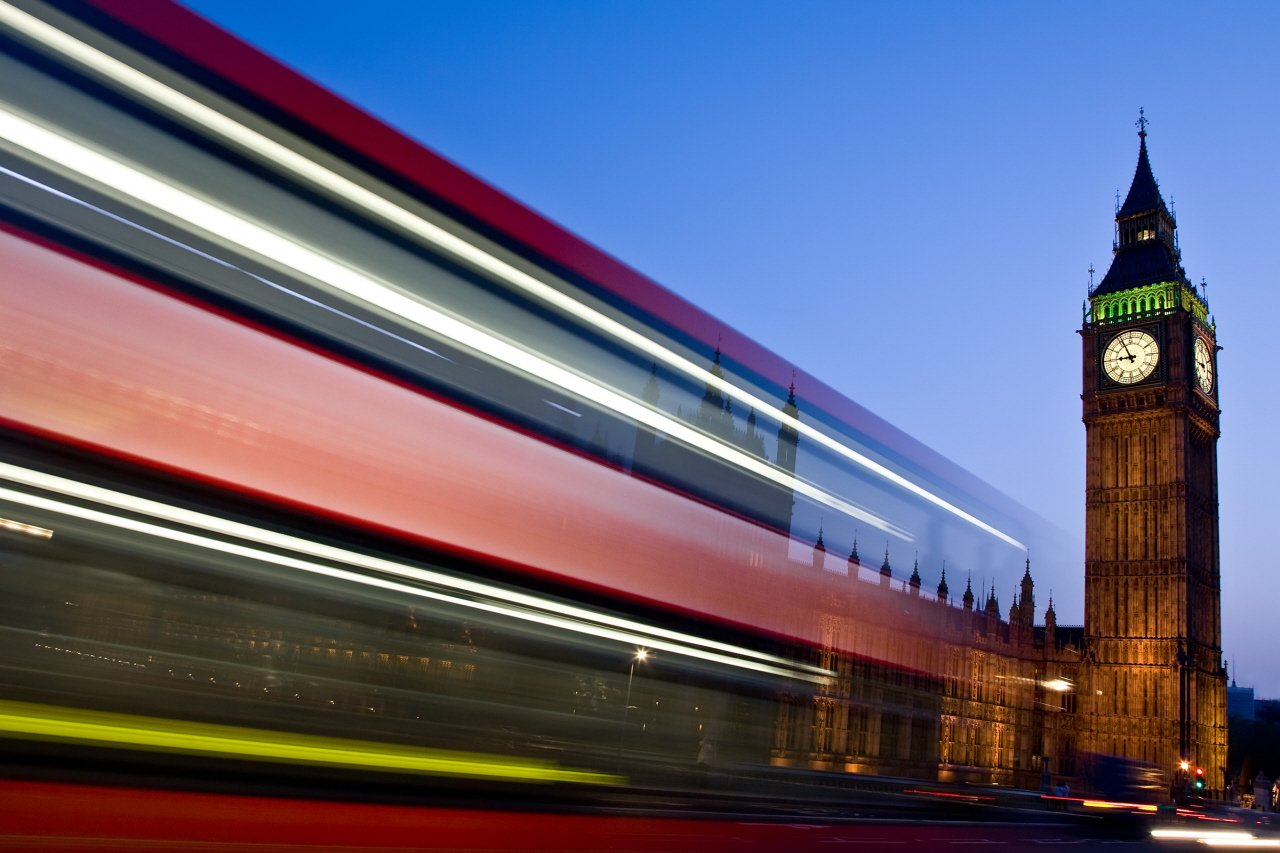 Blurred image of a buses passing by.