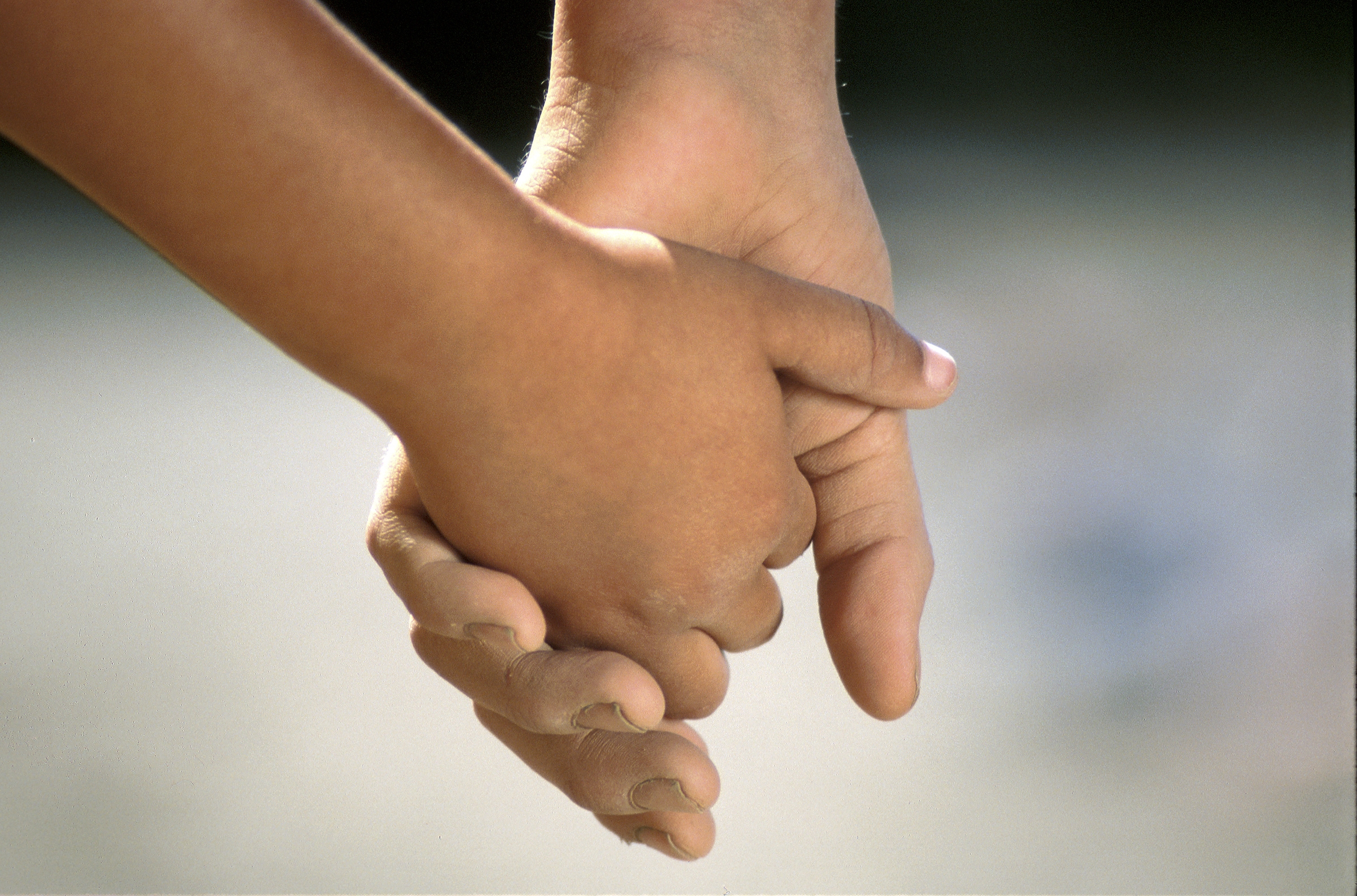 Children's social care image of two children holding hands