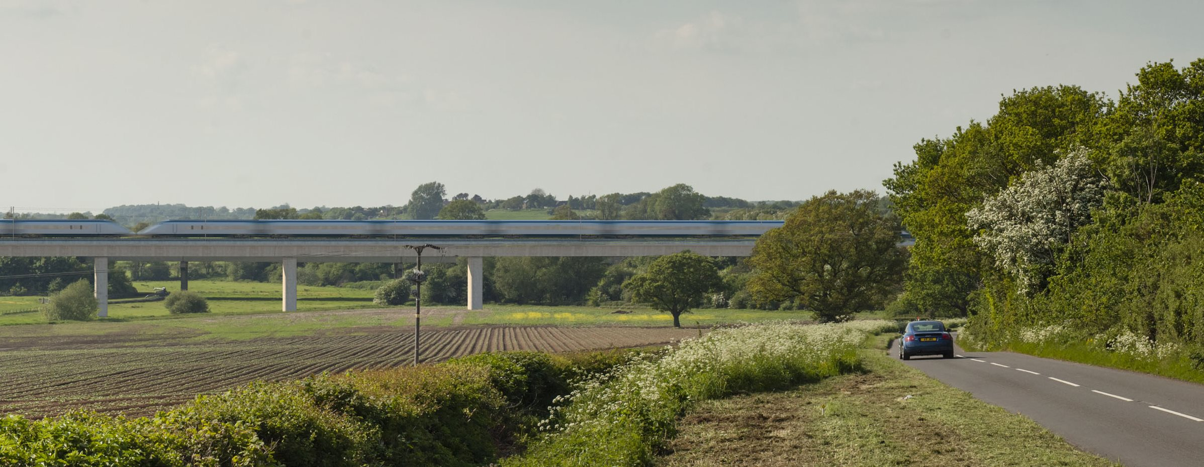 view of HS2 train crossing a rural road