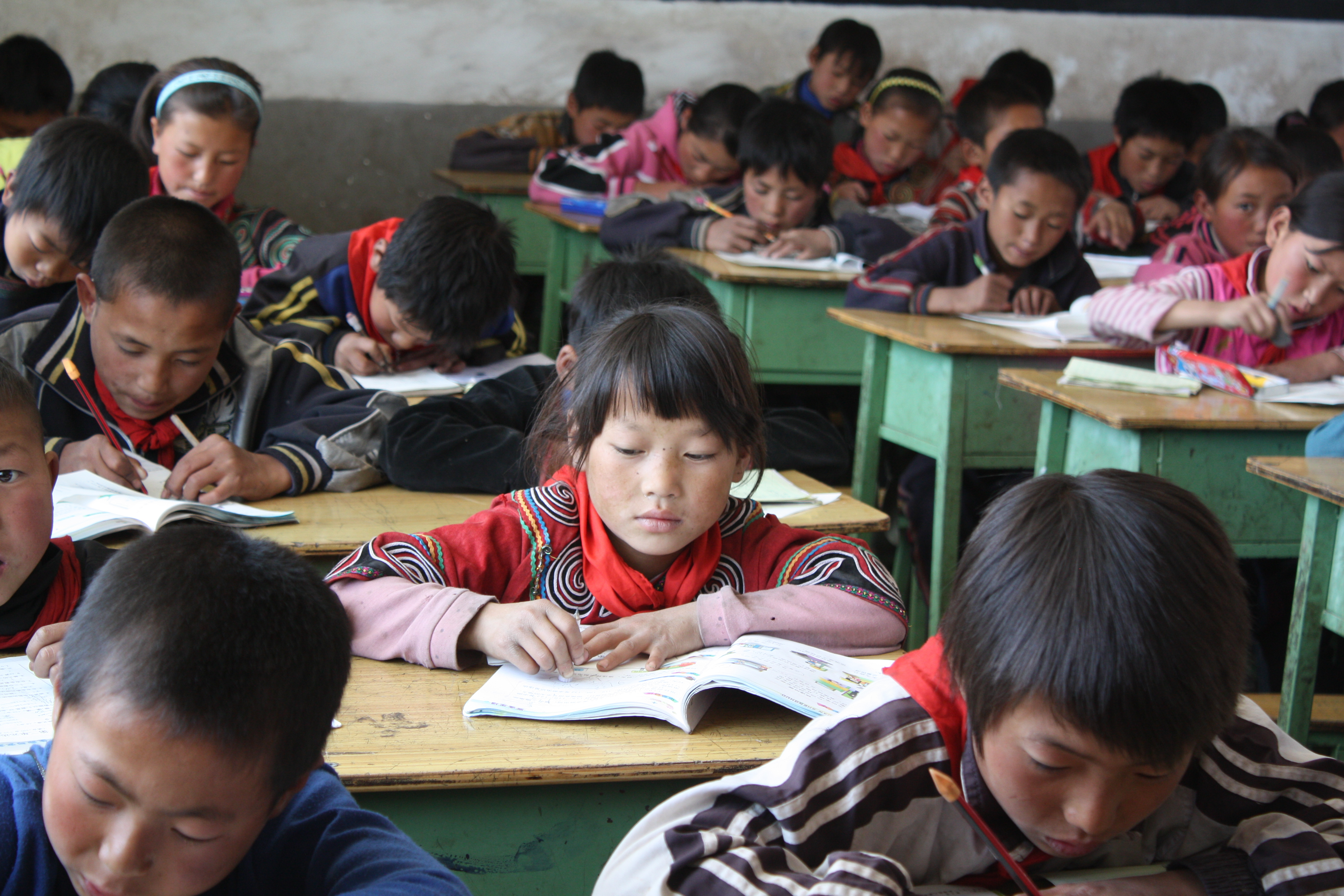 Children in a classroom taking a maths test
