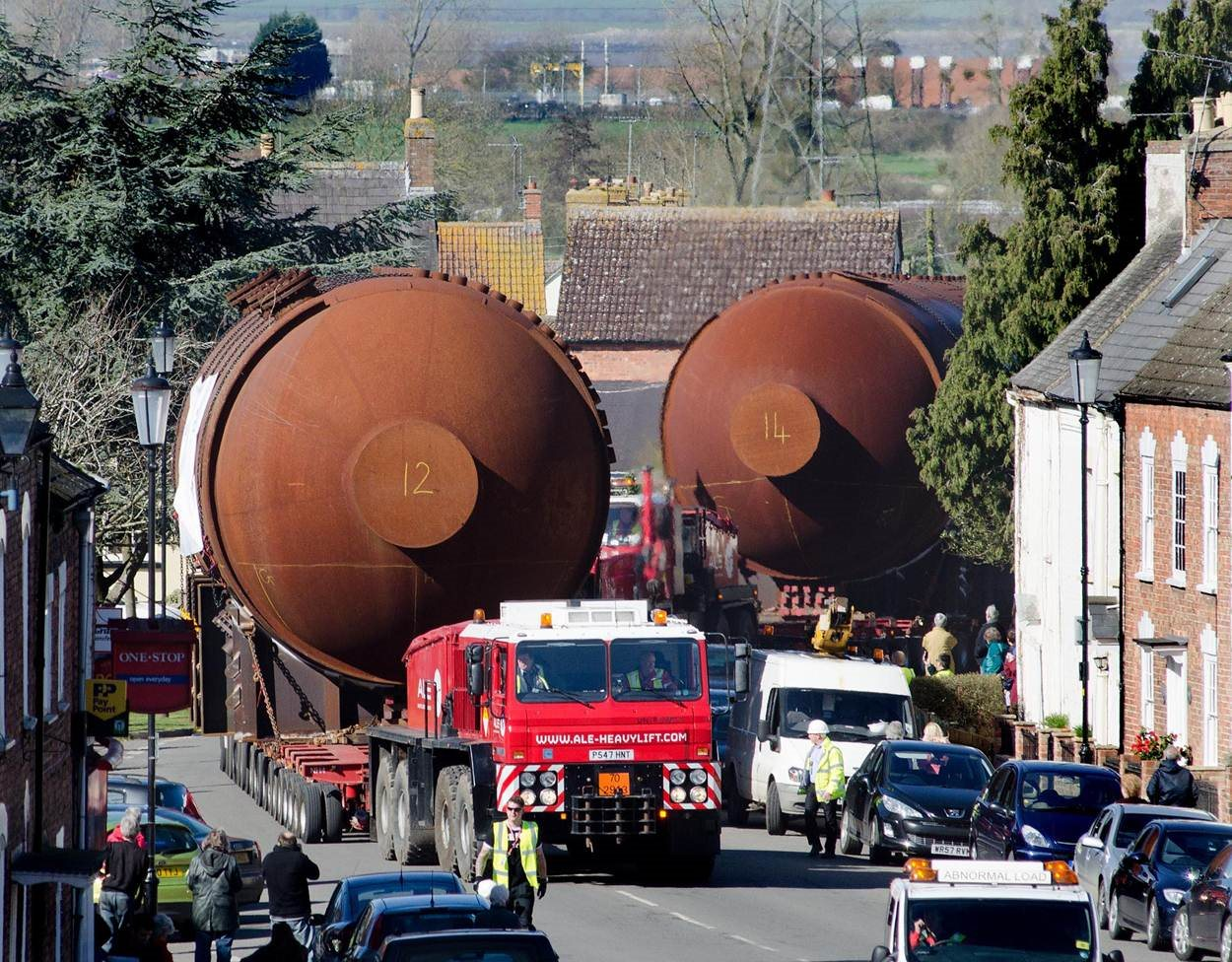 Two of the boilers being transported through the town of Berkeley