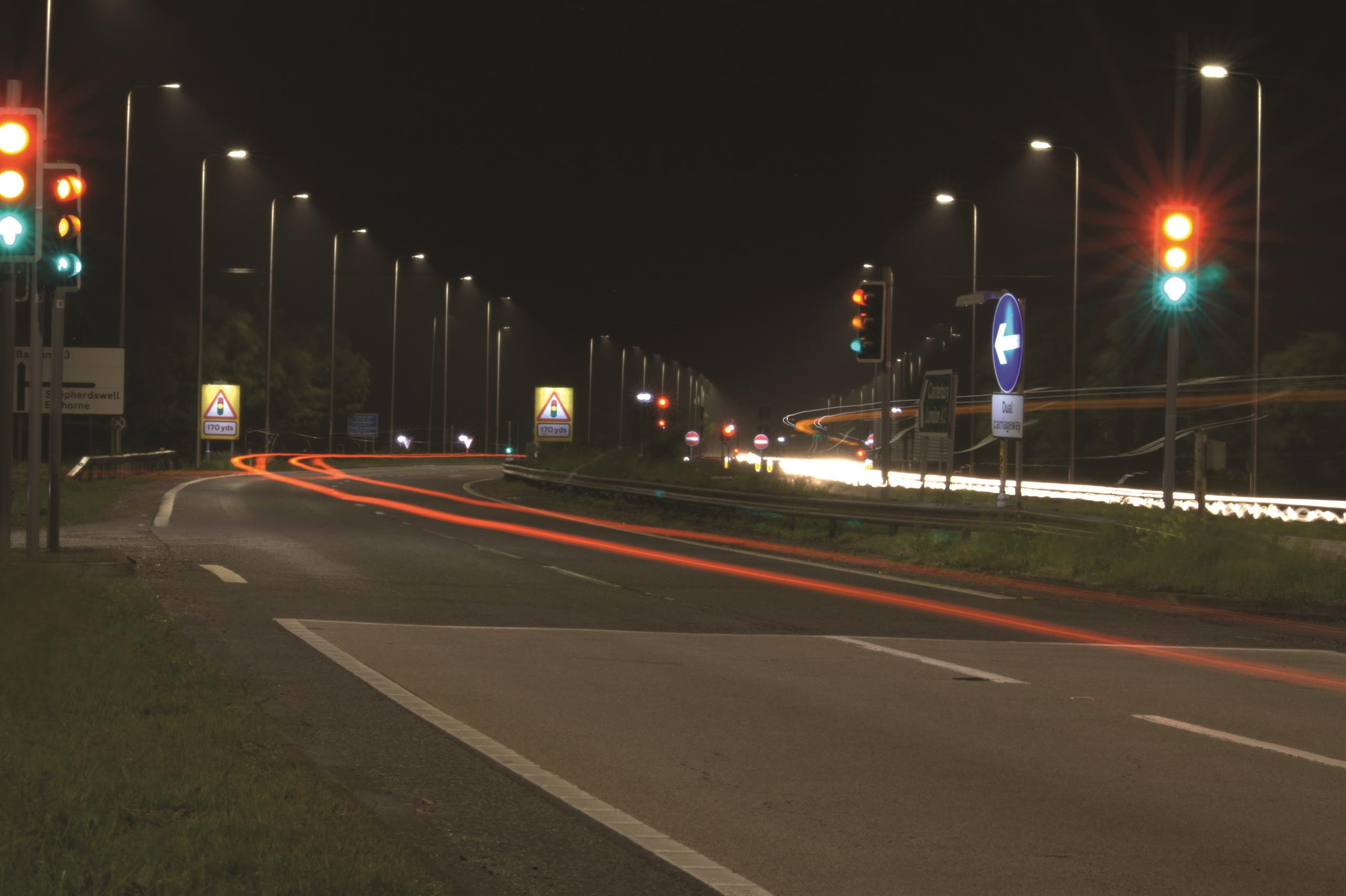 A route lit up on the highway at night