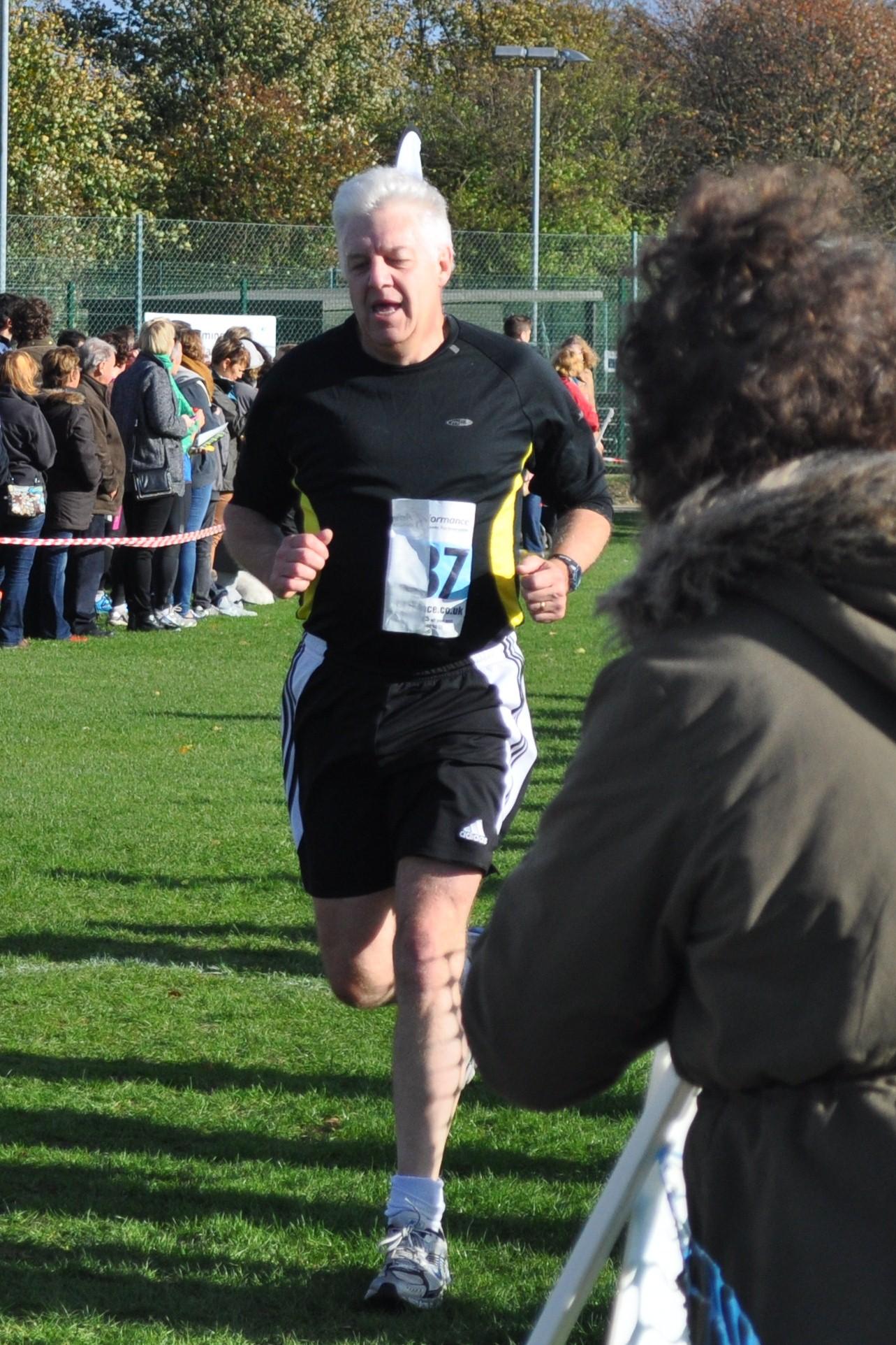 Chris finishing the Bonfire Burn 10K race in November 2013