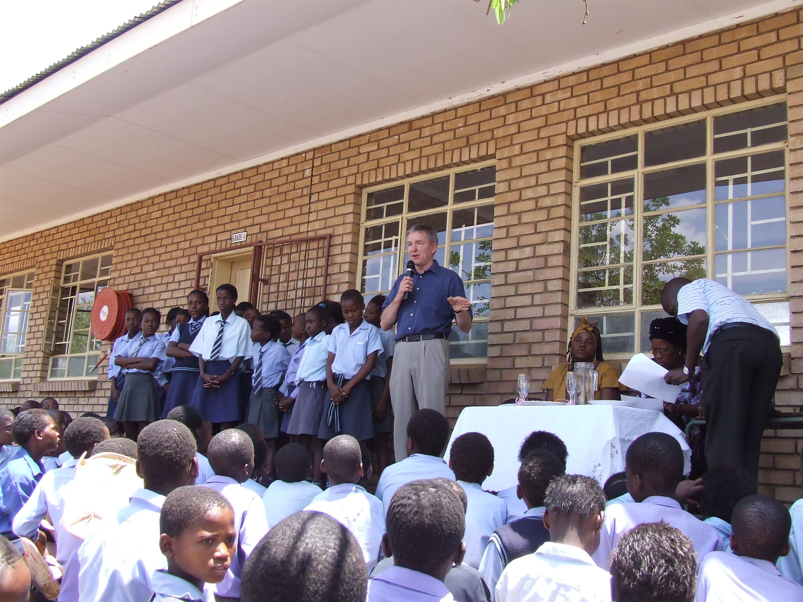 Ron is South Africa talking to a group of children at a primary school.
