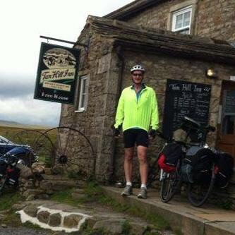 Mike cycling across the North Pennines