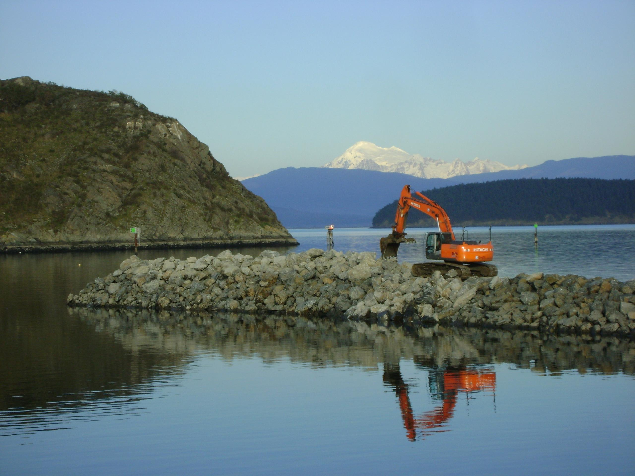 Backhoe working on a jetty