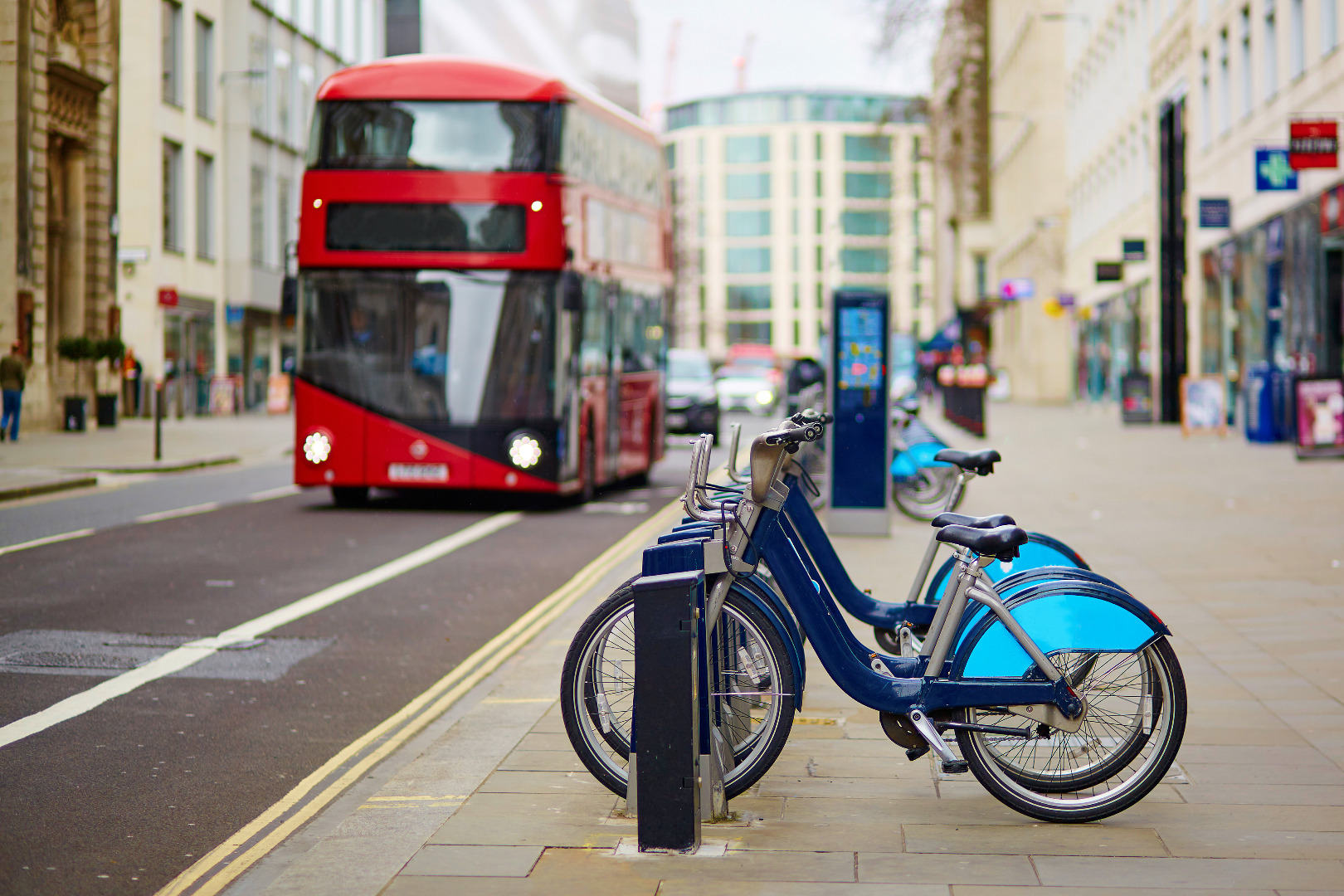 A double decker bus and public bikes in London