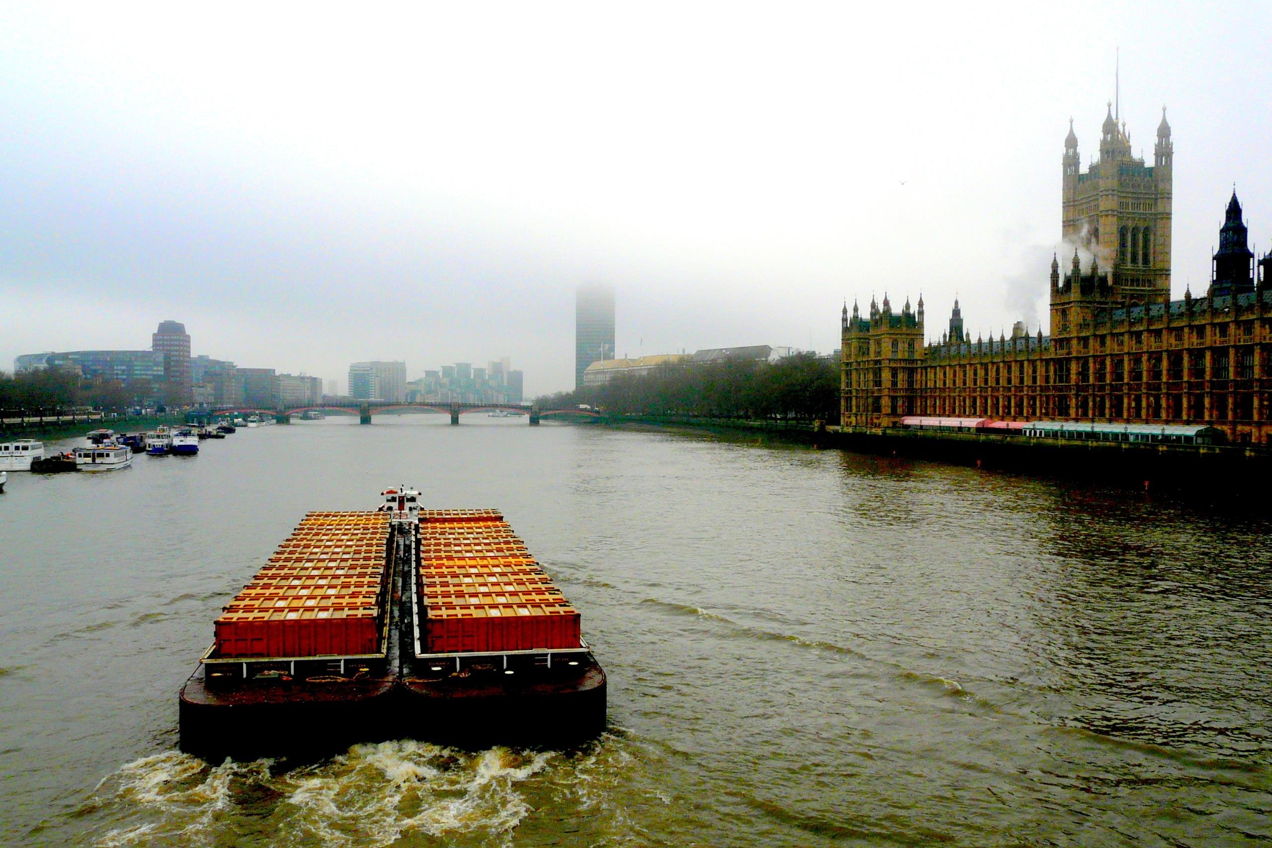 Boat pulling cargo on The River Thames