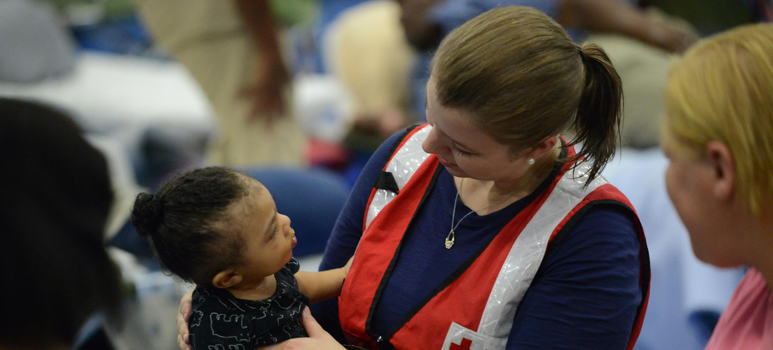 Child being looked after at a red cross shelter in Texas after Hurricane Harvey in 2017.