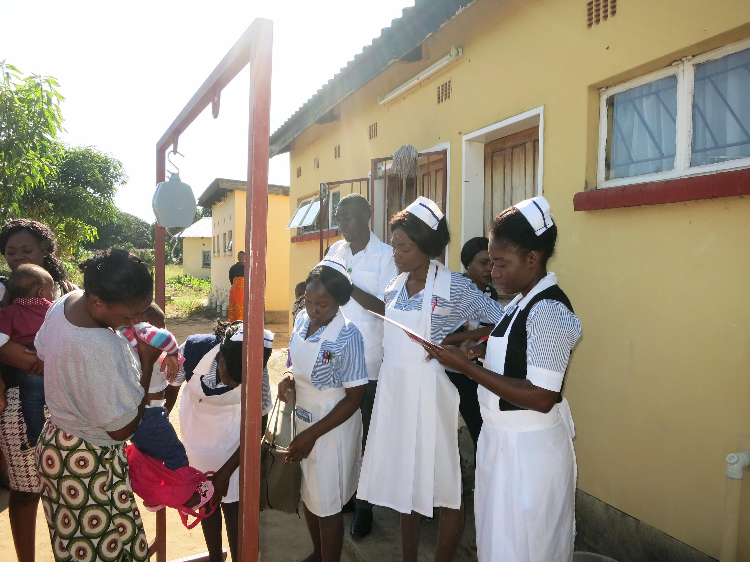 Nurses registering children for an immunisation programme