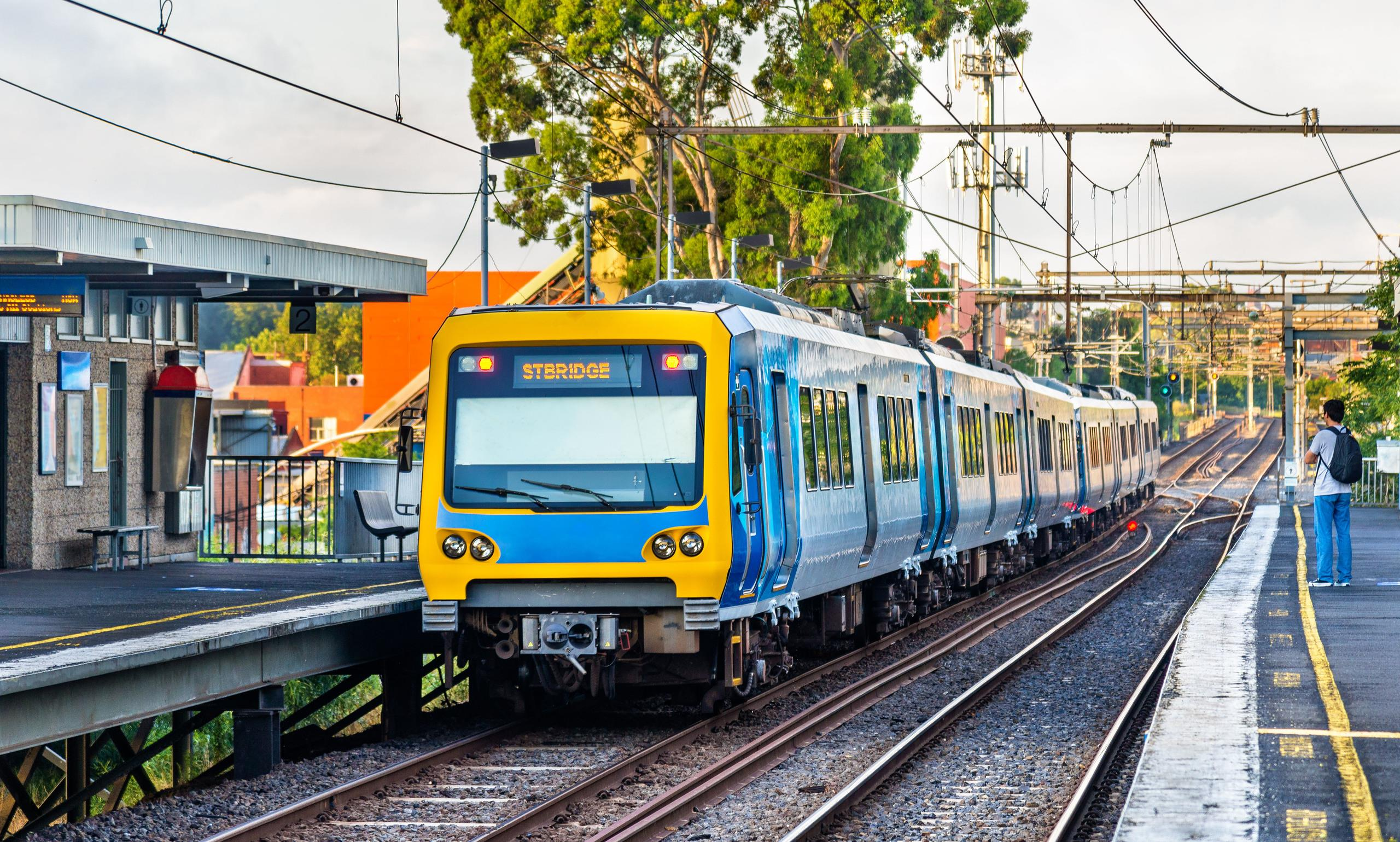 A Melbourne metro train travelling through a station
